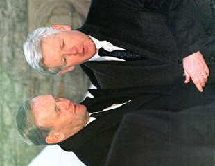 PRIME MINISTER CHRETIEN TRIES TO COMFORT BOB RAE OVER THE LOSS OF HIS FATHER AT FUNERAL.