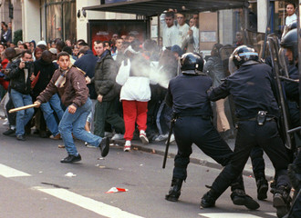 Paris riot policeman shoot tear-gas at a group of hooligans as French high school students  marched ..