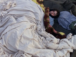 KOSOVO REFUGEE WOMAN SLEEPS iN OPEN AIR IN THE CAMP NEAR SKOPJE.