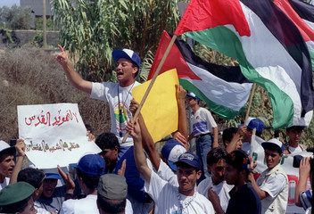 Hundreds of Palestinians demonstrate near the Netsareem Jewish settlement in Palestinian-ruled Gaza ..