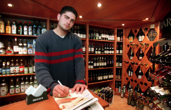 George Zakak stands amidst his $40,000 worth of shelved alcohol bottles in his only liquor store in ..