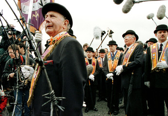 Members of the protestant Orange Order is halted by barbed wire as he attempts to march down the Gar..
