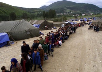 ETHNIC ALBANIAN REFUGEES QUEUE TO BOARD BUSES AT BLACE CAMP.