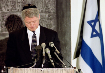 A somber President Clinton finishes his speech during a memorial service at the Israeli Embassy in W..