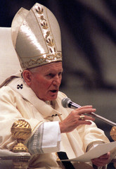 Pope John Paul II reads his message for the Catholic Church's World Day of Peace during a ceremony a..