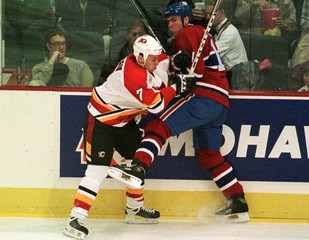 CANADIENS LINDEN AND FLAMES BEGIN COLLIDE IN FIRST PERIOD.