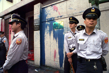 POLICEMEN GUARD THE AIT OFFICE IN TAIPEI.