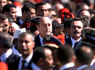 French President Jacques Chirac attends the burial of King Hassan II of Morocco in Rabat July 25. Th..