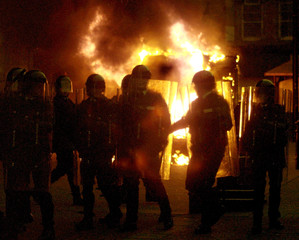 A hijacked van burns in the Guildhall Square in Londonderry after nationalists went on the rampage d..