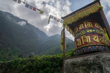 Praying wheel in the Himalayas Nepal
