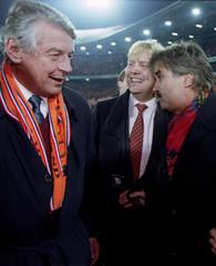 Dutch Soccer coach Guus Hiddink (R) celebrates his team's victory in a group five European Champions..