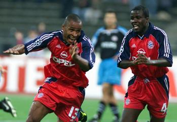 PAULO SERGIO AND SAMUEL KUFFOUR OF FC BAYERN MUNICH CELEBRATE A GOAL.