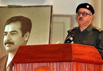 IRAQI DEPUTY PRIME MINISTER TAREQ AZIZ SPEAKS AT A POETRY FESTIVAL IN BAGHDAD.