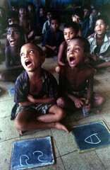Homeless children join a basic education class run by a voluntary organisation in Dhaka's shabby Sad..