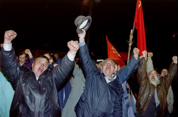 Pro-communist demonstrators shout out anti-Yeltsin slogans in front of the Supreme Soviet building a..