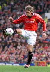 DAVID BECKHAM CONTROLS THE BALL AGAINST WATFORD DURING PREMIERSHIP SOCCER MATCH.