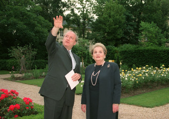 U.S. SECRETARY OF STATE MADELEINE ALBRIGHT LISTENS TO FRENCH FOREIGN MINISTER VEDRINE.
