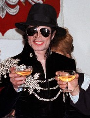 Pop star Michael Jackson  raises a toast with a glass of champagne after signing a preliminary lette..