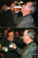 A combo shows German Finance Minister Theo Waigel (R) and Defence Minister Volker Ruehe (L) drinking..