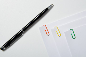bonded paper clips on a white table