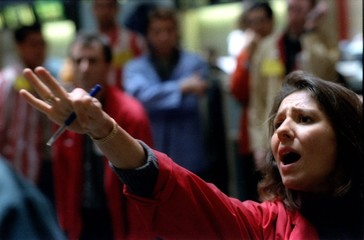 A trader shouts a bid during early trading on the Paris stock exchange, October 18th..