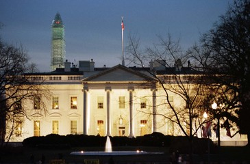 WHITE HOUSE VIEWED WITH WASHINGTON MONUMENT IN BACKGROUND.