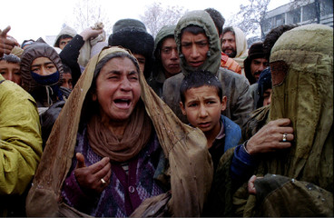 A woman cries in a Kabul street on March 3 after she and other displaced Afghans learnt that a UN fo..