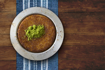 Kanafeh cheese pastry plate on table