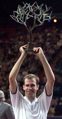 Greg Rusedski of Britain raises the winners trophy after defeating [Pete Sampras of the USA] in the ..