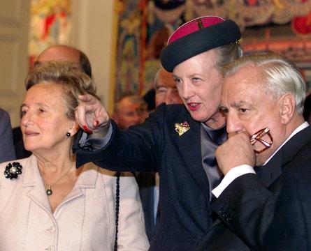 QUEEN MARGRETHE II OF DENMARK EXPLAINS DESIGN ELEMENT AT TAPESTRY EXHIBIT OPENING IN PARIS.