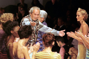 Ottaviano Missoni (C) receives congratulations at the end of his collection at the Spring-Summer '97..