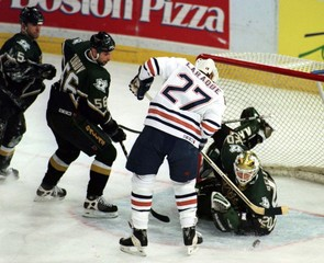 OILERS PLAY THE STARS IN NHL PLAY OFF ACTION.