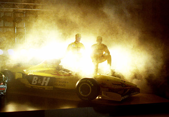 Drivers Ralf Schumacher of Germany (L) and Giancarlo Fisichella of Italy stand beside the Jordan-Peu..