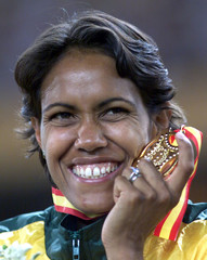 AUSTRALIA'S CATHY FREEMAN SMILES AFTER RECEIVING HER GOLD MEDAL FOR THE 400 METERS.