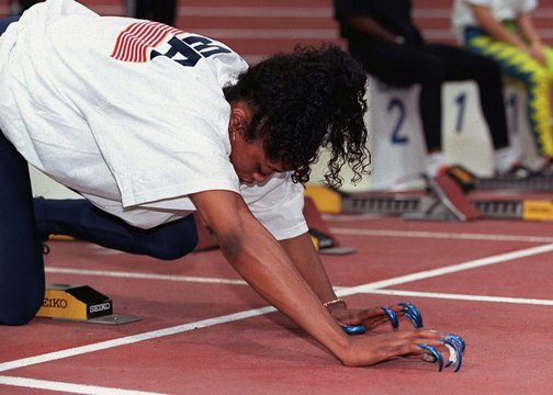 American Gail Devers wearing long nails prepares to start in her women's 60 metres semi final on the..