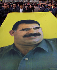 Kurd demonstrators carry a flag with the picture of Kurd rebel chief Abdullah Ocalan in Cologne Nove..