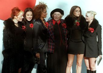 """The all female group """"The Spice Girls"""" pose for a picture with """"The Darling of the Forces"""" Dame Vera.."""