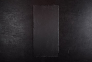 Black background with black stone tray for product presentation