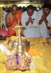 DEVOTEES PRAY BEFORE THE HOLY ASHES AND RELICS OF LORD BUDDHA.
