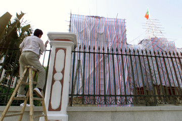 A worker paints an under renovation Government House, the office of Macau Governor Vasco Rocha Vieir..