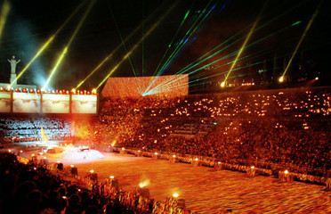 Laser beams light up the night sky over the Marble Stadium during the opening ceremonies of the 6th ..