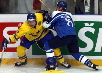 SWEDEN'S JOHNSSON DUELS WITH FINLAND'S SELANNE.