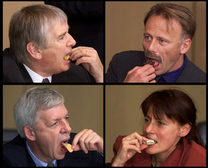 Federal Ministers eat sweets before the start of a meeting of State Prime Ministers, Federal Ministe..