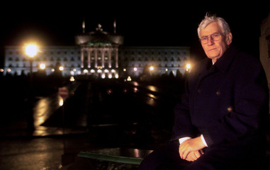SEAMUS MALLON SITS ON A BENCH AT PARLIAMENT BUILDINGS.