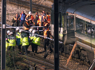 RESCUERS CARRY BODY FROM LONDON TRAIN CRASH SCENE.