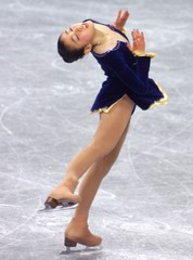 JAPAN'S SUGURI PERORMS DURING WOMEN'S QUALIFYING AT WORLD FIGURE SKATING CHAMPIONSHIPS.