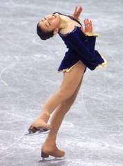 JAPAN'S SUGURI PERORMS DURING WOMEN'S QUALIFYING AT WORLD FIGURE SKATING CHAMPIONSHIPS.