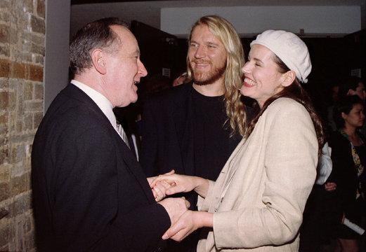 Actress Geena Davis and husband, director Renny Harlin (C) congratulate Gilbert Cates, president of ..
