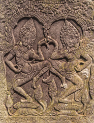 Khmer classical nymphs  and dancers shown in stone - An Apsara (also spelled as Apsarasa) in Bayon temple in Angkor, Siem Reap, Cambodia.