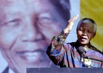 President Nelson Mandela addresses a rally in this township near Pretoria, June 25. He said he wante..